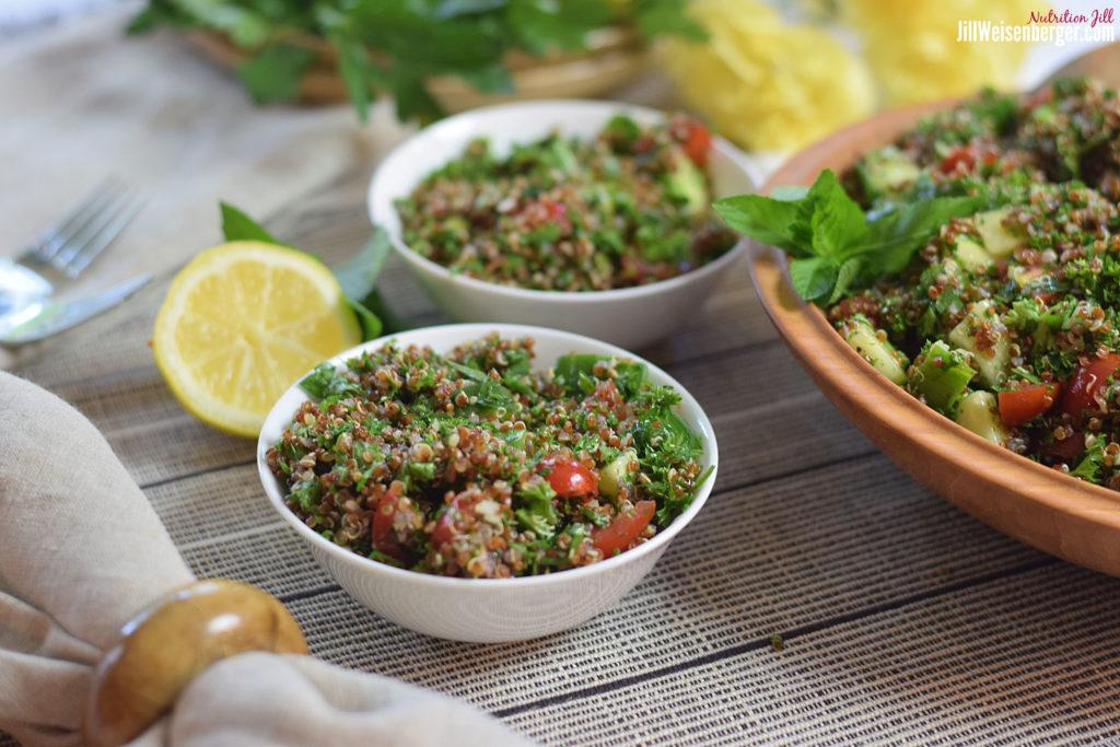 healthy quinoa salad in white bowls