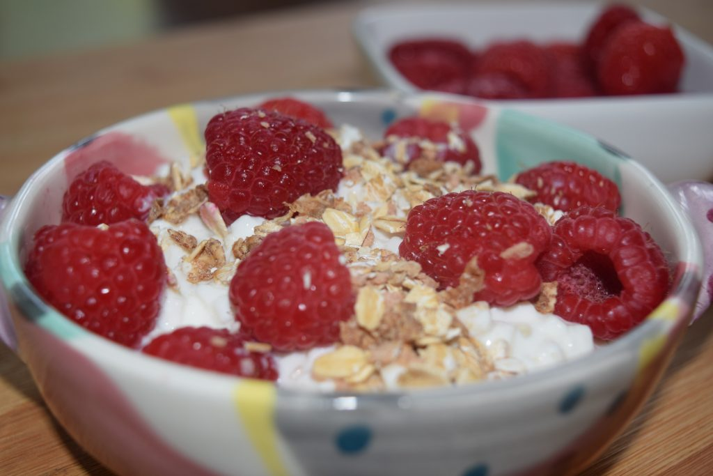 Muesli & raspberries over cottage cheese