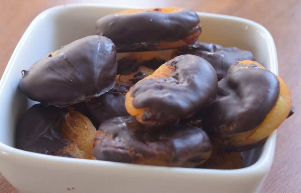 healthier chocolate-dipped apricots in bowl