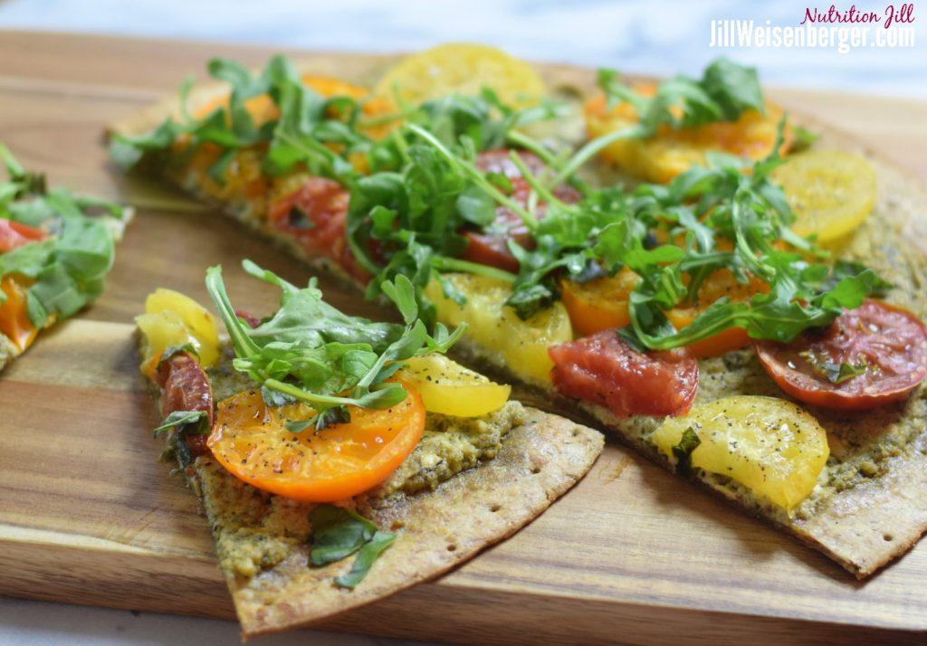 heirloom tomato flatbread on cutting board