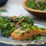 Orange glazed salmon recipe on a plate with salad