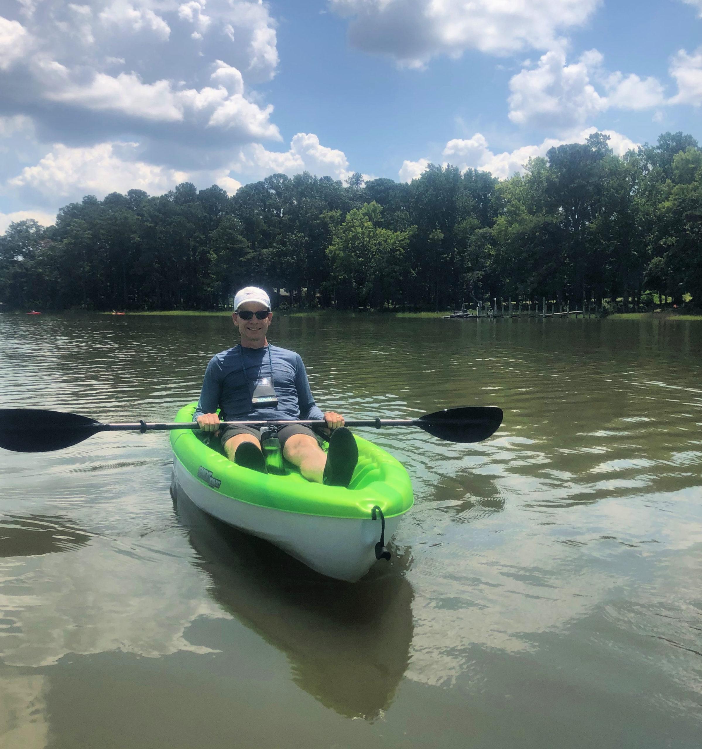 Man floating in a kayak