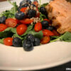 healthy salad of greens, berries and salmon